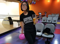 Jen Bellenger with her fancy pink bowling ball and beer in hand at an IST gathering at Albany Bowl