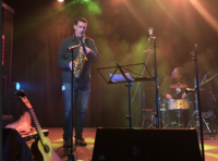 Brian Wood plays sax at IST New Year's event