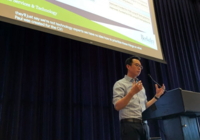 CFO Terence Phuong presents on the IST budget at the all staff meeting Sept. 12