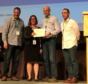 photo of Heidi Wagner, Assistant Dean for Administration, Social Welfare and Max Michel, Enterprise Data Warehouse Dev/Ops Manager, represented the PI Portfolio team accepting a Larry L. Sautter award